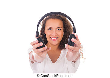 Woman listening to music with headphones isolated