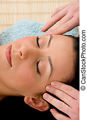 high angle view of woman taking head massage in spa - high...