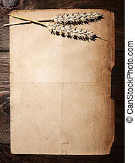Food background - Old dirty paper and rye ears - menu...