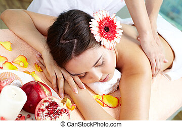Enjoying bodycare - Massage procedure made to relaxed young...