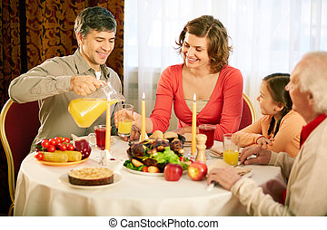 Traditional Thanksgiving dinner - Portrait of happy family...