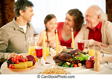 Festivity - Image of festive table with family on background