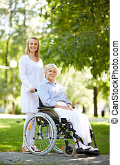Doctor and patient - Pretty nurse walking with senior...