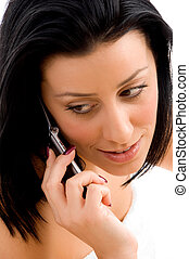 high angle view of young woman talking on cell phone with white background