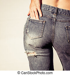 woman wearing denim shorts with holes
