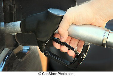 Refilling the car with unleaded petrol