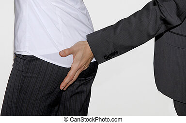 Sexual harassment at work - A business man touching a...