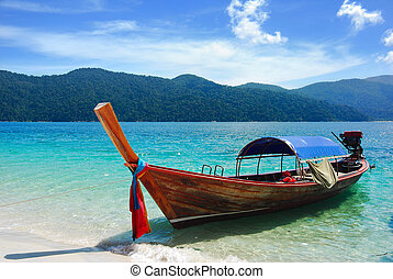 Traditional Thai longtail boat at the beach, Rawi island,...