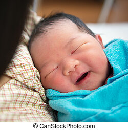 Newborn Asian baby girl and mother