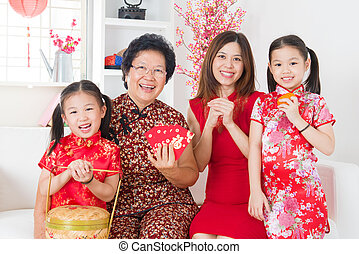 Multi generations Asian family celebrate Chinese new year at...