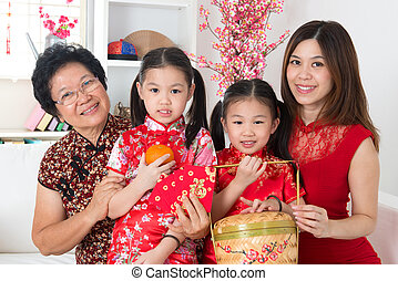 Beautiful multi generations Asian family celebrate Chinese...
