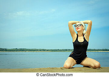 sexy woman on the beach at summer day