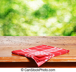 Empty table - Empty wooden table and fresh green bokeh...