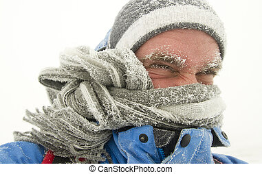 man in winter storm - young man in winter storm with frozen...