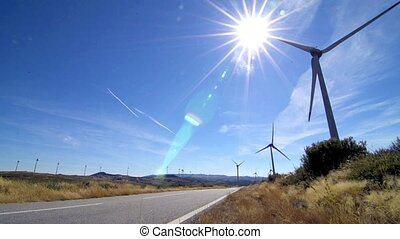 Rotating windmills and paved road Alternative renewable...