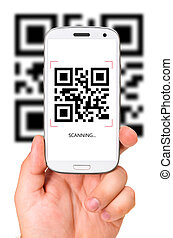 scanning QR code - male hand is holding a modern touch...