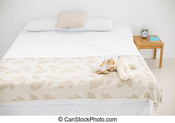 Brightly lit bedroom decorated in white and beige