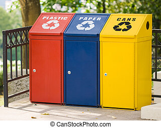 Three recycling bin for cans, plastic and paper...