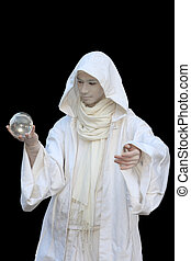White Wizard manipulating christal balls isolated on black...