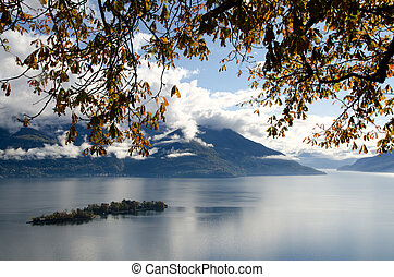 Islands on a alpine lake in autumn with clouds