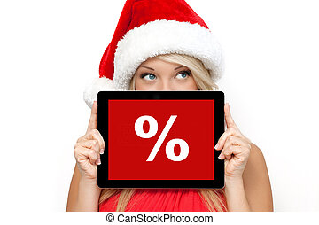 blonde girl in a red Christmas hat on New Year, holding tablet computer touch pad gadget with the word sale on a screen