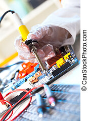 soldering electronic parts on a printed circuit board