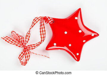 Christmas star ornament of porcelain, on white background