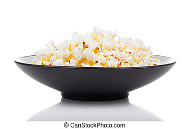 Popcorn in a bowl, isolated on white
