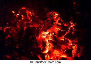 Burning fire wood for a barbecue at night
