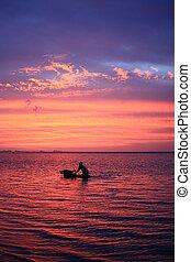 Man bathing buffalo in sunset sea at Samui island,Thailand