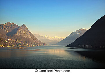 Lake with mountains - Alpine lake with snow-capped mountains