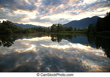 Clouds reflected on a lake - Clouds reflected on an alpine...