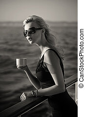 Black&white photo of businesswoman with cup of coffee