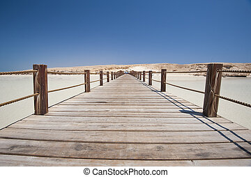 Wooden jetty on a tropical island - Long wooden jetty on a...