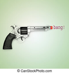 bang - picture of a toy gun and the word bang on a blue...