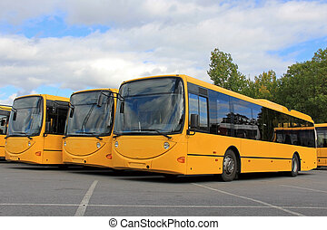 Three Smiling City Buses - Three yellow, smiling city buses...