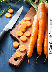 fresh carrot on cutting board