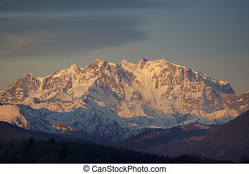Snow-capped mountain monte rosa in morning sunlight