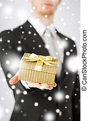 man giving gift box - love, romance, holiday, celebration...