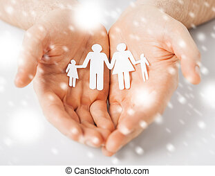man hands showing family of paper people - love, romance,...