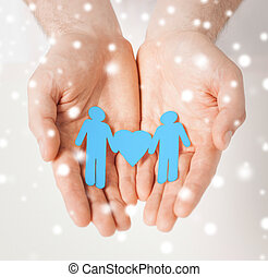 man hands with paper men - love, romance, human rights, gay,...