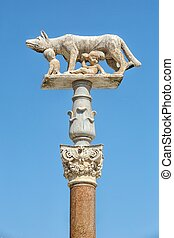 Statue of she-wolf and children in Siena in Italy - A...