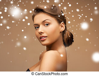 clean face of beautiful young woman - health and beauty...