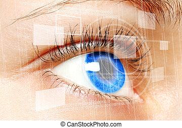 Woman blue eye looking on digital screen