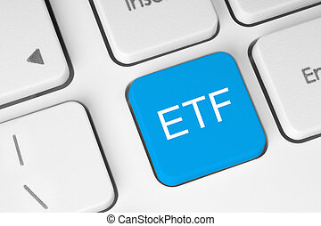 ETF Exchange Traded Fund blue button on white keyboard...