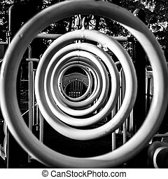 Concentric Rings - A row of monkey bar hanging rings at a...