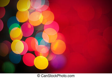 Christmas tree with defocused lights Red background