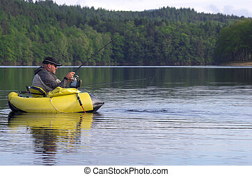 Fishing with a float tube - A fisherman fight against a...