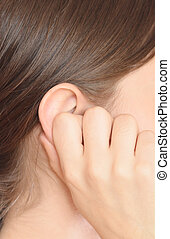 woman ear - young woman holding her ear