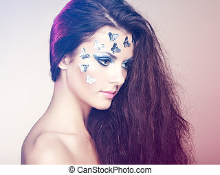 Portrait beautiful young woman with flying hair. Makeup with...